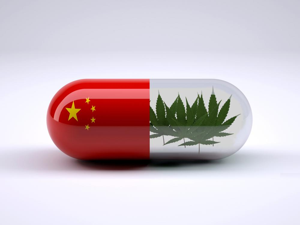 A pill with flag of china on one side and hemp plants on the other side